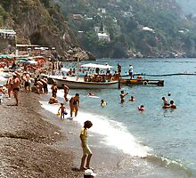 Lady on a beach in Positano, Italy by Elana Bailey