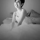 Bride on bed by demistified