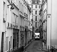 A Delivery Truck Navigates a Narrow Street in Paris by Buckwhite