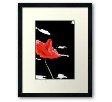 Red poppy on black sky Framed Print