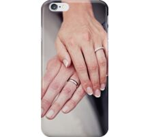 Wedding rings on hands. iPhone Case/Skin