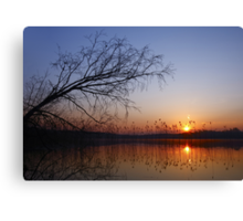 Colorful sunset over water Canvas Print