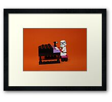 Stormtrooper plays piano Framed Print