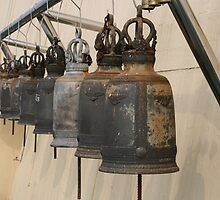 Row of monk Ritual bells by Ashley Hoser