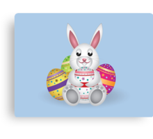 Cute small white lovely bunny with colorful Easter eggs Canvas Print