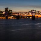 A telephoto look at the Louisville skyline at dusk  by Sven Brogren