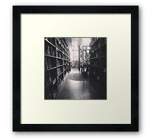 The Dusty Bookstore. Framed Print