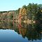 Fall reflections in a small pond  by Linda Jackson