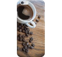 Espresso and beans on a table iPhone Case/Skin
