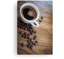 Espresso and beans on a table Canvas Print