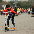 Korean Boy on a 3 Wheeled Scooter (2) by Christian Eccleston