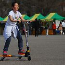 Korean Girl on 3 Wheeled Scooter by Christian Eccleston