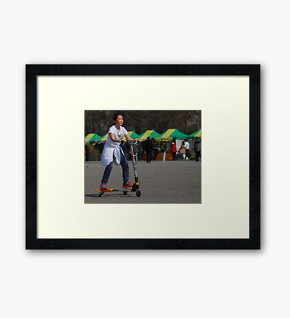 Korean Girl on 3 Wheeled Scooter Framed Print
