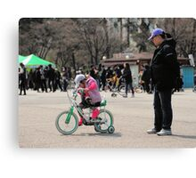 Mom Teaching Daughter to Ride a Bike Canvas Print