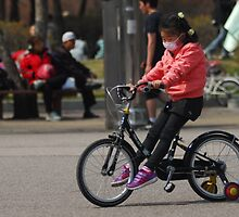 Young Korean Girl Learning to Ride a Bike by Christian Eccleston