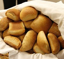 Basket of Dinner Rolls by BravuraMedia