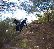 me and renee climbing a rock by lahbay