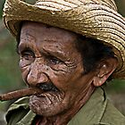 Cuban farmer and Cigar, Vinales, Cuba by buttonpresser