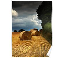 Straw Bales under a stormy sky Poster