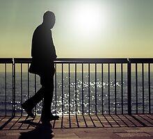 Dark silhouette of a walking man  by ONiONAstudio
