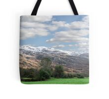 rocky mountain and fields countryside snow scene Tote Bag