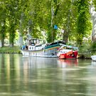 Three boats by the canal by Jacinthe Brault