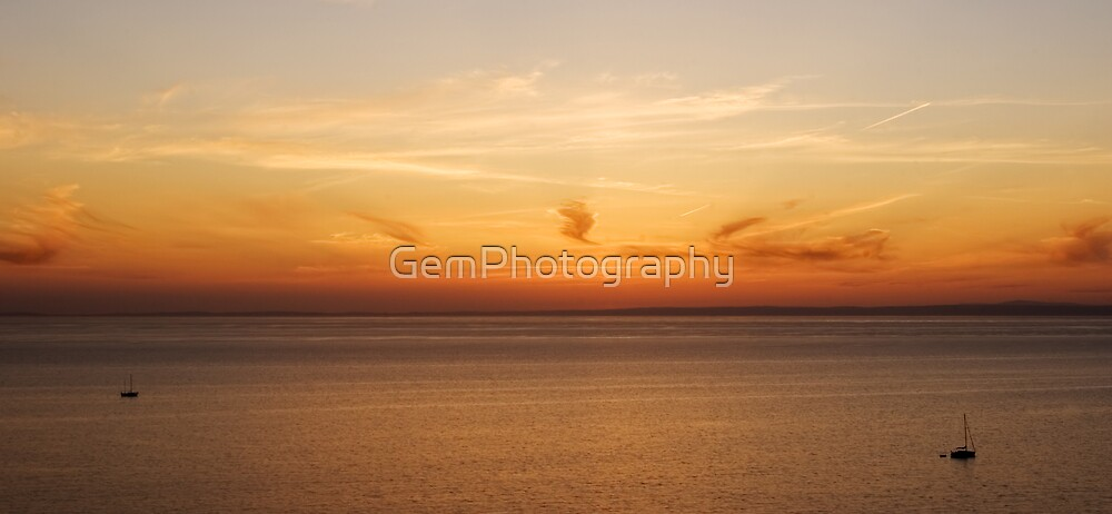 BLAZING SUNSET OVER THE OCEAN by GemPhotography