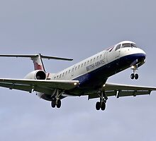 Embraer 145 on short finals by Colin Hollywood Photography