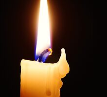 Candle with melted wax against dark background. by Oleg Zaslavsky