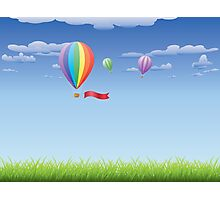 Hot air balloons over grass field Photographic Print