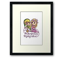 It's dangerous to play alone Framed Print