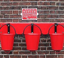 Three red buckets, Hanging on the wall by Yampimon