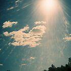 A picture of the sky with sun shining through by conceited