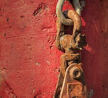 Rusty Chain On A Concrete Post by James Eddy