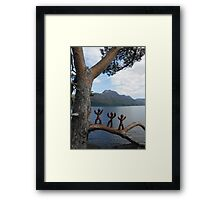 Clay people climbing trees Framed Print