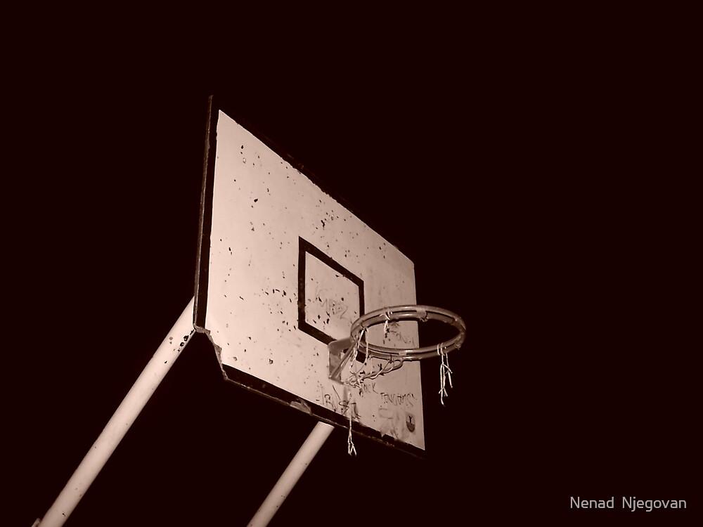 beaten up bball hoop by Nenad  Njegovan