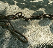 Rusted Chain and Slag by RodneyK