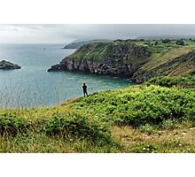 A man looking at the sea at Bery Head, Devon Photographic Print