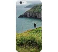 A man looking at the sea at Bery Head, Devon iPhone Case/Skin