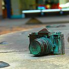 Bronze Nikon SLR by Tony Hadfield
