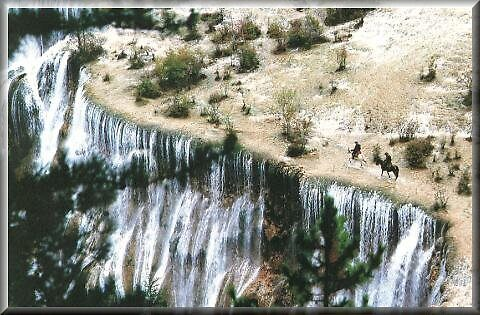 Takla Makan desert and waterfall in China by chord0