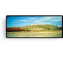 little red railway carriage and slag heap... Canvas Print