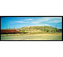 little red railway carriage and slag heap... Photographic Print