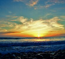 Sunset over Pebbles by Ray Smith