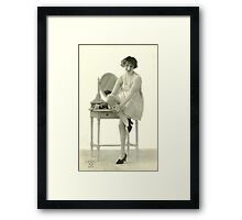 By the Mirror Framed Print
