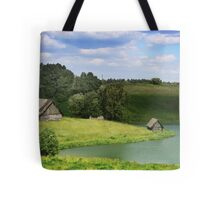The old village by a lake in Lithuania Tote Bag