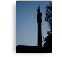 The saint and the moon Canvas Print