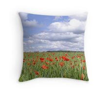 Field of poppies under cloudy sky Throw Pillow