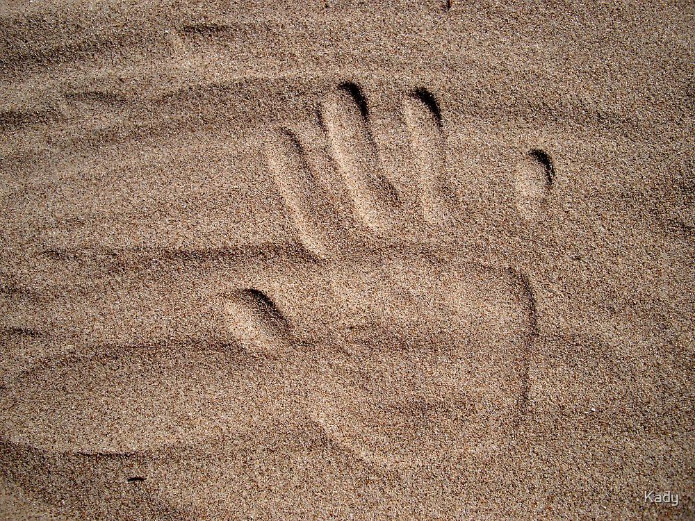 Handprint in sand by Kady