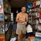 Happy Shop Keeper - Hanoi - Vietnam by Malcolm Heberle